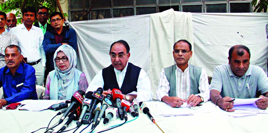 BNP candidate Mirza Abbas speaking at a press conference on `BNP candidates participating in the eleventh parliamentary elections are in arrest and attack panic` at his residence in the city`s Shajahanpur on Tuesday.