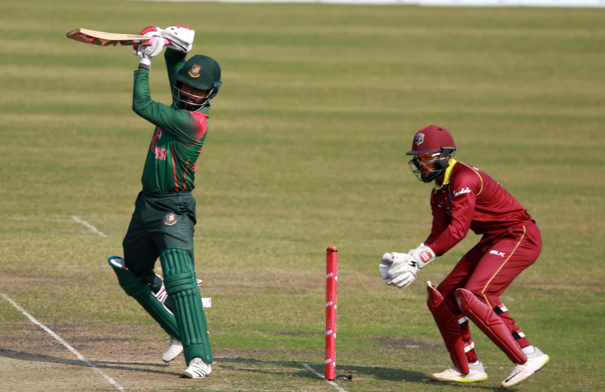 Opener Tamim Iqbal (left) of Bangladesh plays a shot during the second One Day International match between Bangladesh and West Indies at the Sher-e-Bangla National Cricket Stadium in the city's Mirpur on Tuesday.