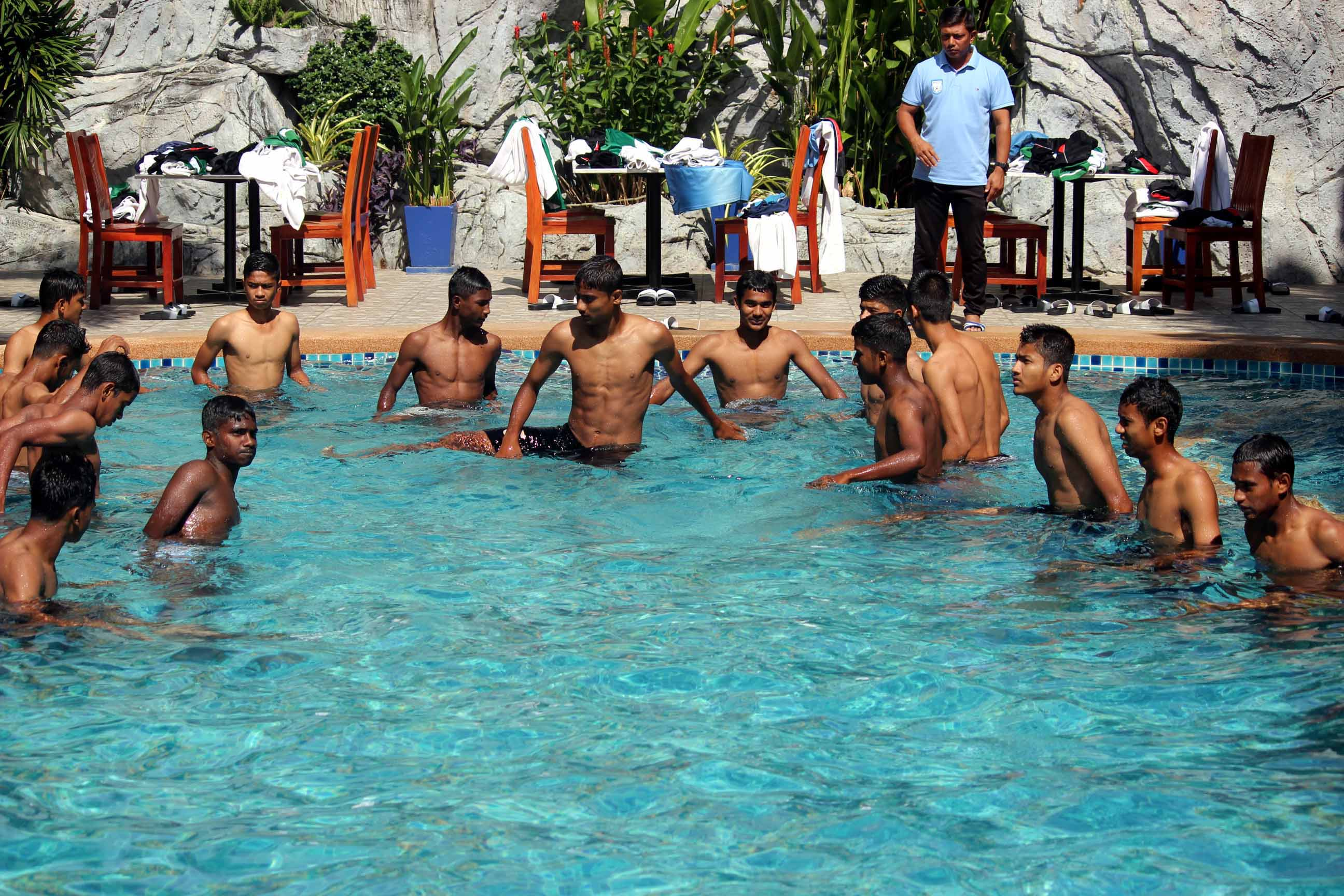 Members of Bangladesh Under-15 Football team passing their time at a swimming pool in Thailand on Tuesday.