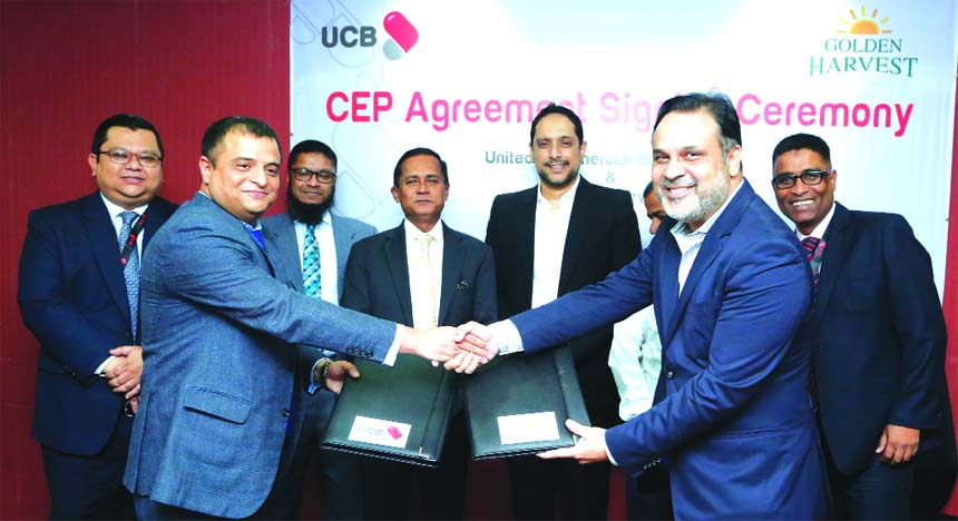 Sajib Kumar Basak, EVP of United Commercial Bank Limited (UCBL) and Samad Chowdhury, Director of Golden Harvest Group, exchanging an agreement signing document at the Banks head office in the city recently. Under the deal, employees of Golden Harvest Group will enjoy Corporate Executive Package solutions from the Bank. Mohammed Shawkat Jamil, Managing Director of the Bank and Rajeeb Samdani, Managing Director of Golden Harvest Group were also present.