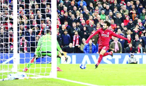 Alisson heroics ensure Liverpool through in Champions League