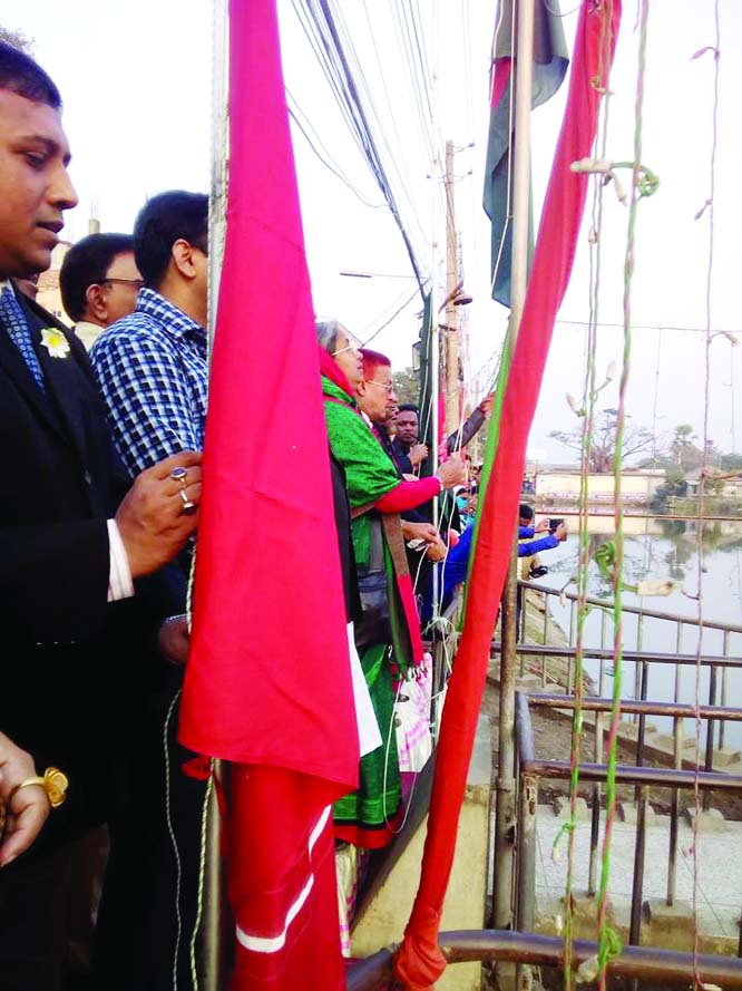 CHANDPUR : Dr Dipu Moni MP  inaugurating the month -long 'Muktijuddher Bijoy Mela'  by hoisting  national flag  in front of Ongiker - a memorial monument of 1971,   as Chief Guest   at  Chandpur Hasan Ali High School ground on  December 8.