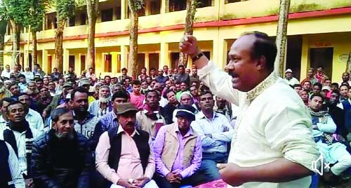 KISHOREGANJ:  Minister for Labour and Manpower and 14- Party Alliance candidate for Kishoreganj -3 Seat Mujibur Hoque Chunnu MP addressing an election campaign at Tarail Muktijoddha Govt College compound recently.
