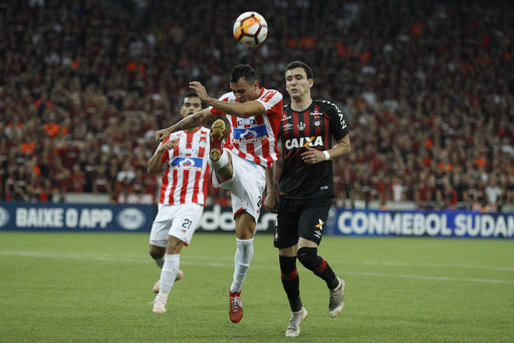 Marlon Piedrahita of Colombia's Junior kicks the ball challenged by Pablo of Brazil's Atletico Paranaense (right) during the Copa Sudamericana final soccer match at the Arena da Baixada stadium in Curitiba, Brazil on Wednesday.