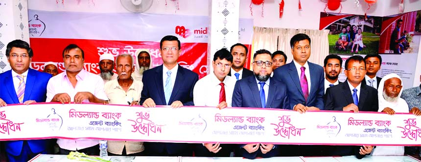 Ahsan-uz Zaman, Managing Director of Midland Bank Limited, inaugurating its an Agent Banking Centre at Guzia Bazar in Shibgonj Sadar Upazila in Bogura on Wednesday. Senior official of the Bank and local elites were also present.