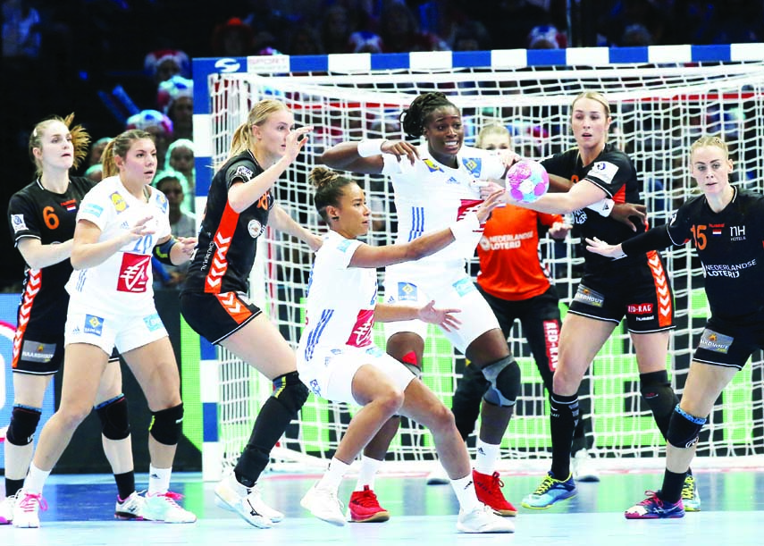 France's Estelle Nze Minko (center) gives the ball away during the Women's European Handball Championship semifinal match between Netherland and France in Paris, France on Friday.