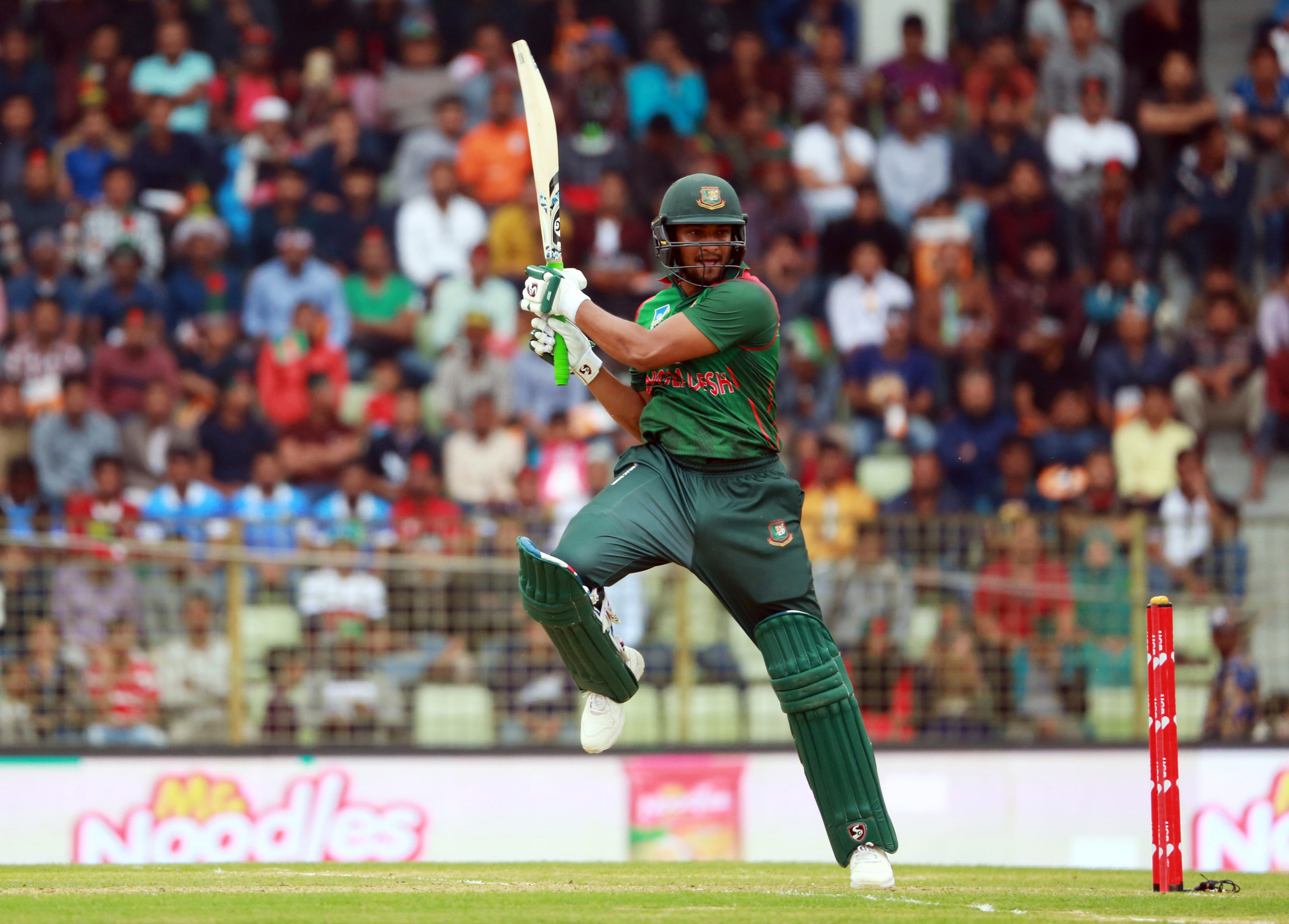 Shakib Al Hasan plays a shot during the first Twenty20 International match between Bangladesh and West Indies at Sylhet International Cricket        Stadium on Monday. Shakib scored 61 runs.