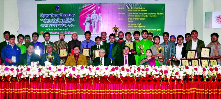 Vice-Chancellor of Dhaka University Prof Dr Akhtaruzzaman  poses for photo session with the recipients of Provost Awards of Bijoy Ekattor Hall of DU in its auditorium on Tuesday.