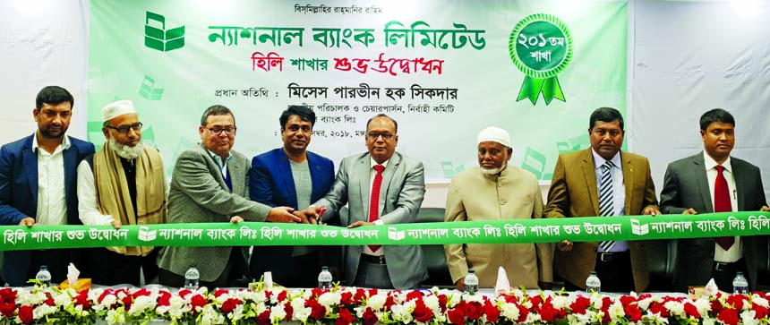 Parveen Haque Sikder, EC Chairperson of National Bank Limited, inaugurating its 201st branch at Hili Land Port on Tuesday. Ali Haider Mortuza, Vice-President, other officials of the Bank, local businessmen and elites were also present.