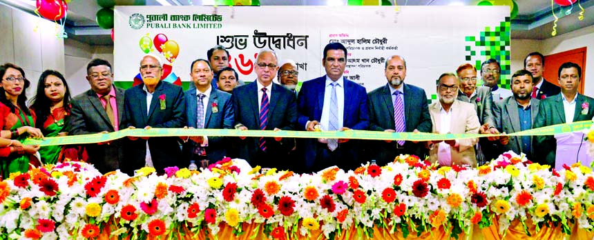 Md. Abdul Halim Chowdhury, Managing Director of Pubali Bank Limited, inaugurating its 469th branch at Fulbaria in Mymensingh recently. Safiul Alam Khan Chowdhury, AMD, Mohammad Ali, DMD, Md. Rafiqul Islam, Mymensingh Regional Manager of the Bank and local elites were also present.