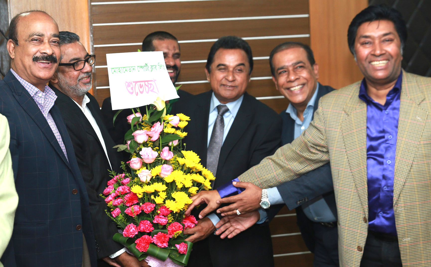 Representatives of Dhaka Mohammedan Sporting Club Ltd welcomed the Finance      Minister A H M Mustafa Kamal with flowers at his own office of Economic Relations            Division at Sher-e-Banglanagar in the capital on Sunday. Director in-charge of the club    Lokman Hossain Bhuiya, Director Mahbub Anam, Director Rejaur Rahman Shohag, among others, were present on the occasion.