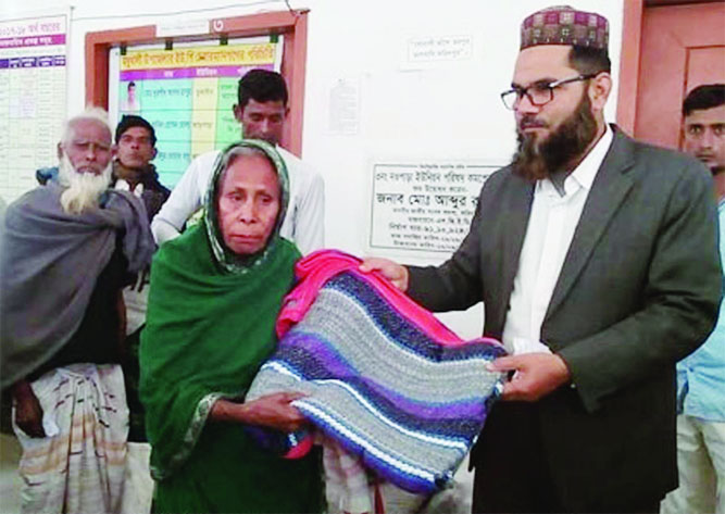 MADHUKHALI(Faridpur): Md Habibur Rahman Mollah, Chairman, Noapara Union Parishad distributing blankets among the poor people on Monday.