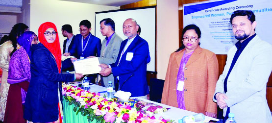 RANGPUR: Prof Dr Nazmul Ahsan Kalimullah,VC, Begum Rokeya University giving certificates  as Chief Guest among the trainee female students on completion of 'Women Entrepreneurship Training'  on Monday.