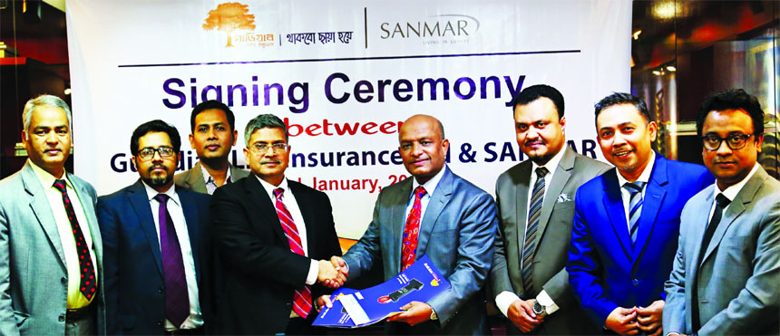 Major (Retd.) Nizam Uddin Ahmed, Chief Operating Officer (Corporate Admin & HR) of Sanmar Group and M M Monirul Alam, Managing Director of Guardian Life Limited (GLIL), exchanging an agreement signing document to ensure Group Life and Health Insurance coverage for the employees of the group along with their family members at GLIL head office in the city recently. Top officials from both the sides were also present.