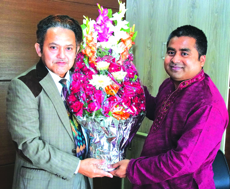 Young entrepreneur Sayed Atiq, congratulating with bouquet to Nazmul Hossain, Deputy Managing Director of Unimed Unihealth Pharmaceuticals Limited, for her outstanding contribution in the company.