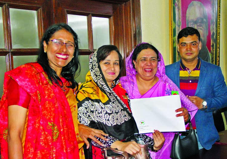 Advisory Counci member of Badalgachhi Upazila Awami League Begum Sakhina Siddique bought nomination form for the reserved women seat of the 11th parliamentary election for Naogaon district Awami League. The snap was taken from the city's Dhanmondi AL office on Tuesday.