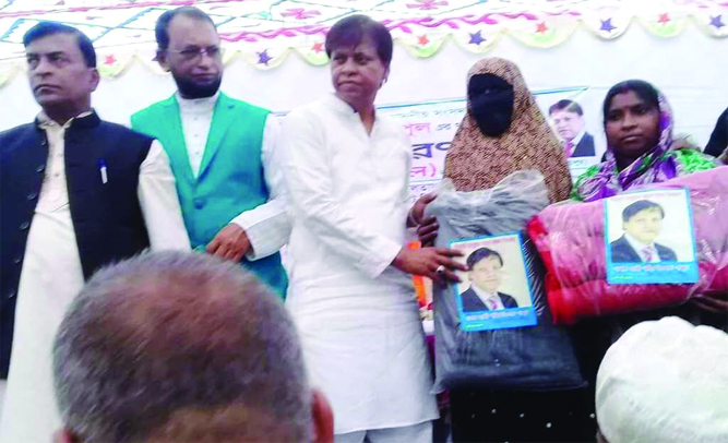 FENI:  Kazi Shaheed Islam Papul, MP,  distributing warm clothes among the poor people at Sonapur Union on Monday.
