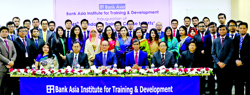 Rumee A Hossain, EC Chairman of Bank Asia Limited, poses for a photograph with the participants of the 49th Foundation Training Course for Management Trainees at the Banks Institute for Training & Development (BAITD) in the city on Tuesday. Md. Arfan Ali, Managing Director, KS Nazmul Hasan, Head of People Management Division (HRD), Md. Azharul Islam, Head of Training and Krishna Saha, AVP of the Bank were also present.