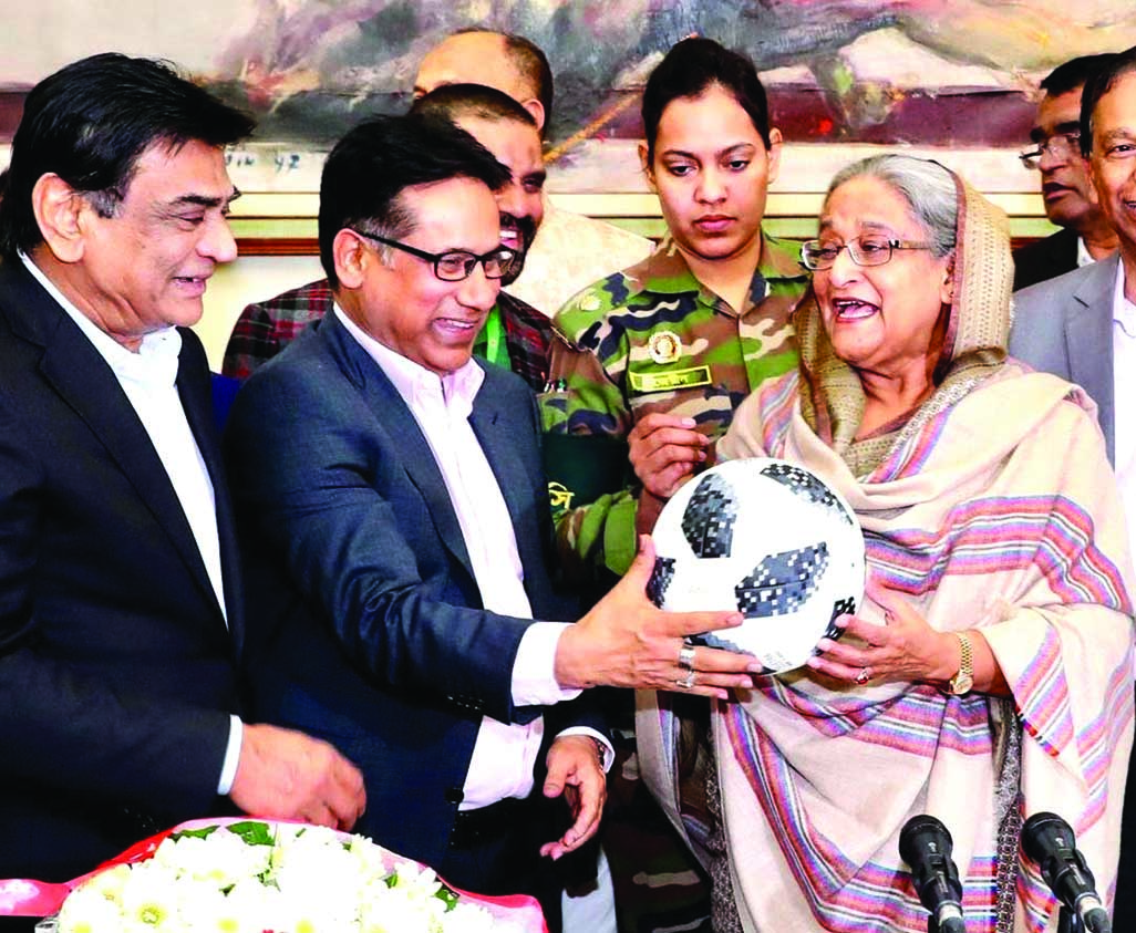Awami League President and Prime Minister Sheikh Hasina receiving a football ( as a souvenir) from Senior Vice-President of Bangladesh    Football Federation (BFF) Abdus Salam Murshedy, MP, when a delegation of BFF led by its President Kazi Md Salahuddin met her at the Gono Bhaban on Tuesday night.