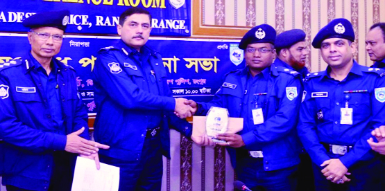 RANGPUR: Devdas Bhattacharya , Deputy Inspector General , Rangpur Range Police distributing awards among the best police personnel at the monthly  law and order review  meeting  at  Conference Room on Tuesday.