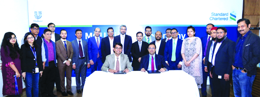 Kedar Lele, CEO of Unilever Bangladesh Limited (UBL) and Naser Ezaz Bijoy, CEO of Standard Chartered Bangladesh, poses for a photograph after signing an agreement to avail the 'Supply Chain Finance' programme (a financing program for the dealers and suppliers of the Bank's corporate clients) at UBL's head office in the city recently. The program with UBL is a first-of-its-kind, fully automated financing program, in which all financing steps will be processed online.  Top officials from both the organizations were also present.