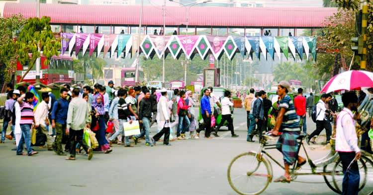 As traffic week continues for 3rd consecutive day on Thursday, a group of people passing the busy road defying traffic rules and ignoring nearby foot-over bridge in city's Shahbagh Intersection.
