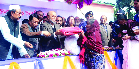 PANCHAGARH: State Minister for Disaster and Relied Dr Enamur Rahman MP distributing blankets and dry food among the poor people at Sakoa High School as Chief Guest on Wednesday.