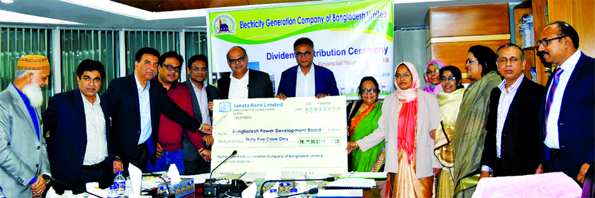 Dr Ahmad Kaikaus, Chairman of Electricity Generation Company of Bangladesh Limited (EGCB) and also Secretary of Power Division, handing over a dummy cheque of Tk. 35.00 crore to Engr. Khaled Mahmood, Chairman of Bangladesh Power Development Board at its corporate office in the city recently. AKM Firoz, Managing Director of EGCB and other officials of the company were also present.