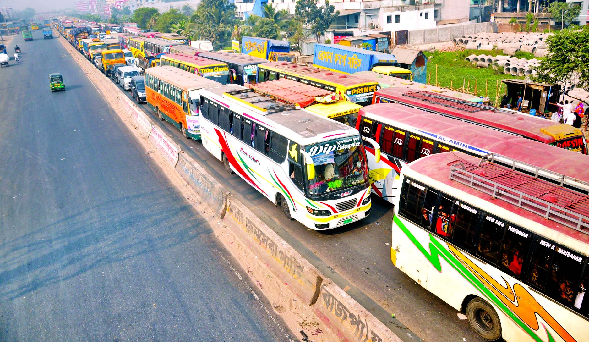 Hundreds of vehicles remain stuck as 20km traffic gridlock on the one side of the Dhaka-Chattogram Highway causing sufferings to commuters at the week end day. This photo was taken from Madanpur area on Friday.