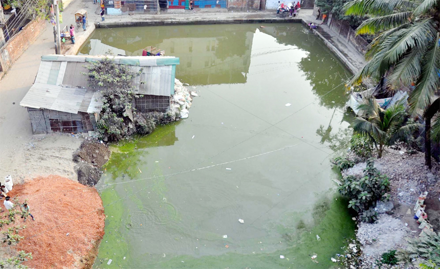 The thousand years old pond at Pahartoli area has been grabbed by influential businessmen. This snap was taken yesterday.