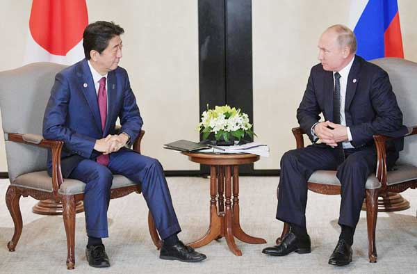 Abe, Putin on collision course over islands
