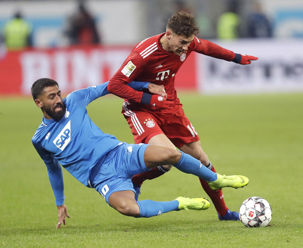 Hoffenheim's Kerem Demirbay (left) and Bayern's Leon Goretzka challenge for the ball during a German Bundesliga soccer match between TSG 1899 Hoffenheim and Bayern  Munich in Sinsheim, Germany on Friday.