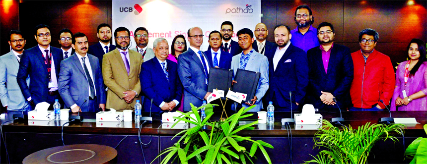 Md. Abdullah Al Mamoon, DMD of United Commercial Bank (UCB) Limited  and Hussain Elius, CEO of Pathao Limited, exchanging an agreement signing documents on providing the convenience of payment for Pathao services using Upay, Digital Payment System of the at its Corporate office in the city recently. Mohammed Shawkat Jamil, Managing Director of the Bank and other senior executives from both the organizations were also present.