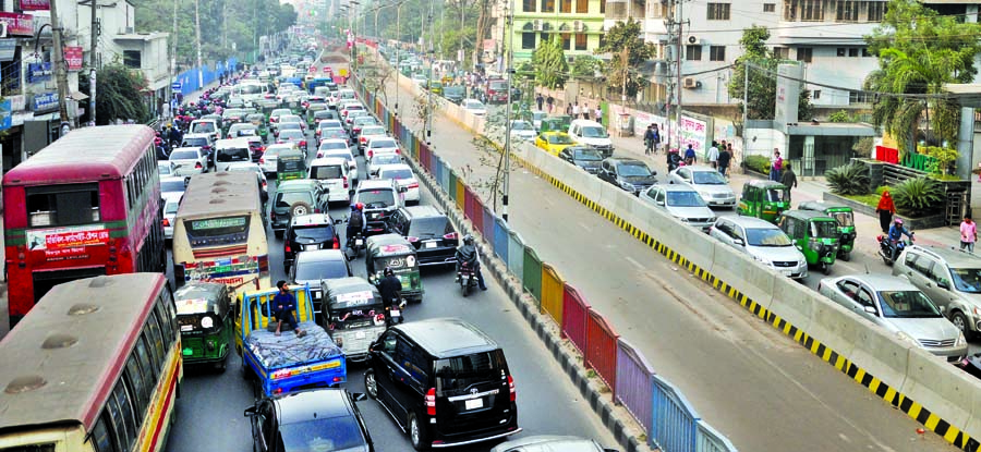 Hundreds of vehicles got stuck in a traffic gridlock on both sides of city street due to on going work of metro rail project. This photo was taken from Bangla Motor area on Sunday.