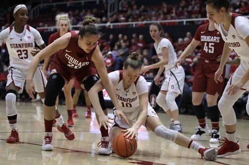 Washington State center Maria Kostourkova (20) and Stanford's Alyssa Jerome (10) chase a loose ball during the first half of an NCAA college basketball game in Stanford, Calif on Sunday.