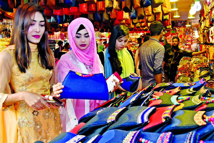 Buyers busy in choosing the best one at Dhaka Int'l Trade Fair on Monday.