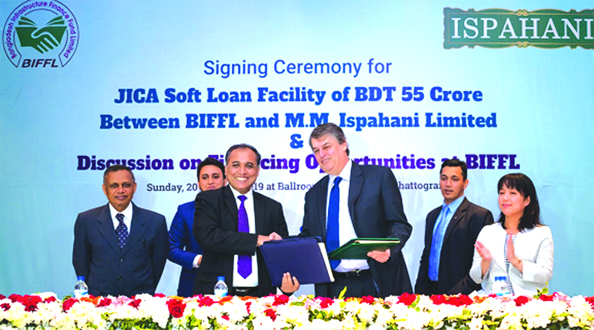S M Formanul Islam, CEO of Bangladesh Infrastructure Finance Fund Limited (BIFFL) and Mirza Salman Ispahani, Chairman of MM Ispahani Limited, exchanging an agreement signing document for a financing up to Tk. 55crore under the Energy Efficiency & Conservation Promotion Financing (EECPF) of JICA for setting-up an energy-efficient Textile Mill named