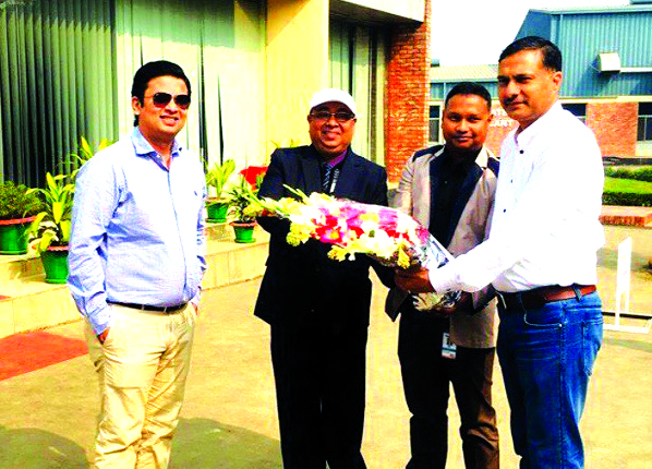 Taskeen Ahmed, Deputy' Managing Director of IFAD Group presenting a bouquet to Acting High Commissioner of India in Bangladesh Dr. Adarsh Swaika at the company's factory premises at Ashulia in Dhaka recently. The Commissioner expressed his satisfaction over the quality of the products and the factory environment.