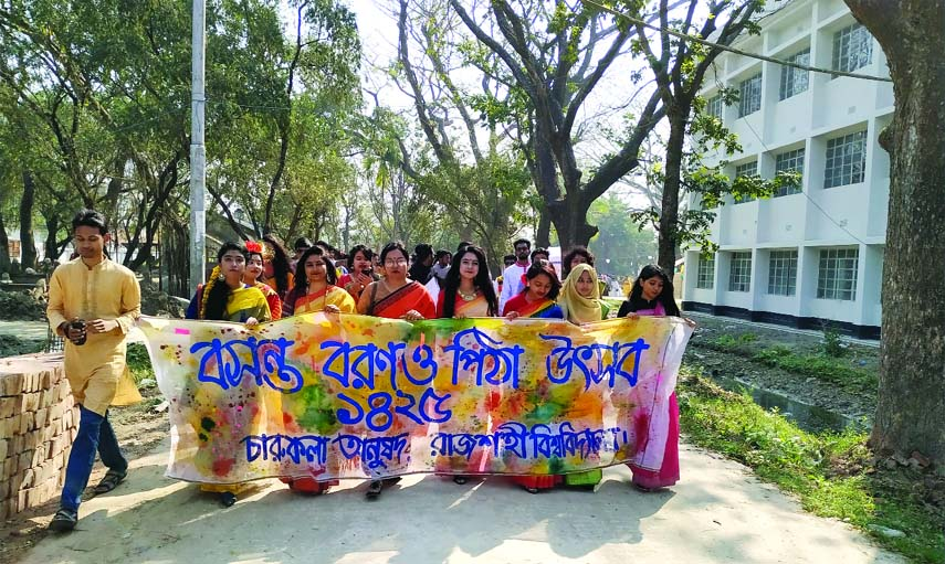 RAJSHAHI UNIVERSITY: Students of  Charukala  Department of Rajshahi University  brought out a rally marking the Pahela Falgun on Wednesday .