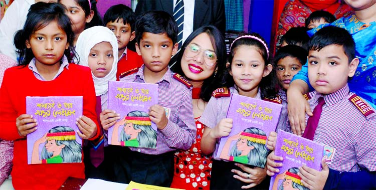 Shanu with her book among children