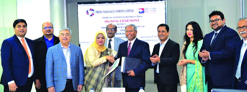 Mohammodi Khanam, CEO of Prime Insurance Company Limited and Dr. Shakti Ranjan Paul, Chairman of Life and Health Limited and Adviser of Bangkok Hospital, exchanging an agreement signing document on Medical Services at Unique Heights in the city recently. Md. Zakiullah Shahid, Chairman, Shaeda Parvin Trisha, Vice-Chairperson and other members of the company and dignitaries from the hospital were also present.