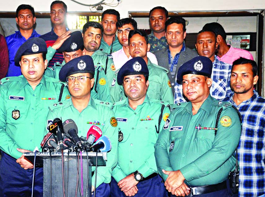 Deputy Police Commissioner of Ramna Zone Maruf Hossain speaking at a prèss briefing about arrest of two persons involved in killing former Principal of Eden Mahila  College Mahfuja Chowdhury Parvin at New Market Thana on Friday.
