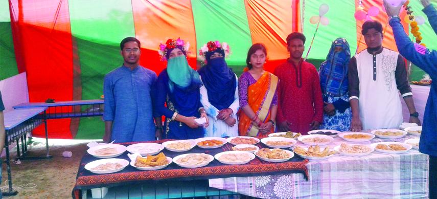 GOPALGANJ: Students of Bengali Department of  Bangabandhu Sheikh Mujibur Rahman Science and Technology University (BSMRSTU) at  Ghonapara passing busy time in cake selling on Thursday.