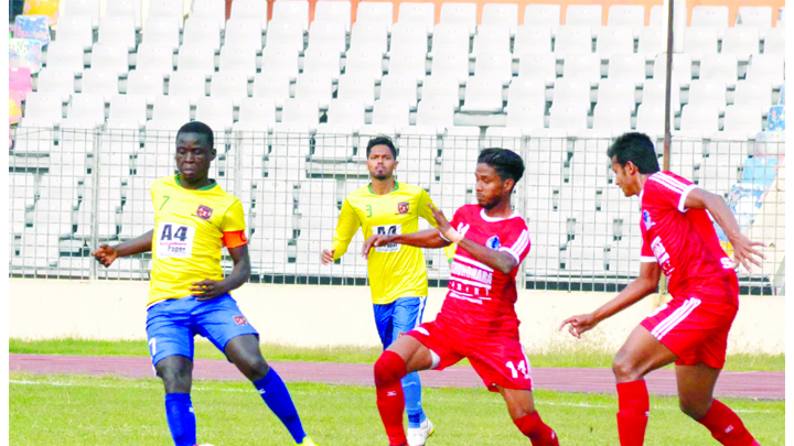A moment of the football match of the Bangladesh Premier League between Sheikh Jamal Dhanmondi Club Limited and Sheikh Russel Krira Chakra Limited at the Bangabandhu National Stadium on Sunday. The match ended in a goalless draw.