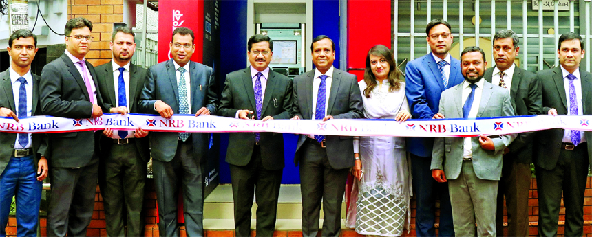 Md. Mehmood Husain, CEO of NRB Bank Limited, inaugurating a new ATM Booth at city's Gulshan area on Sunday. Md. Khurshed Alam, DMD, Imran Ahmed, Chief Operating Officer and Mohammed Golam Nakib, head of branches of the Bank among others were also present.