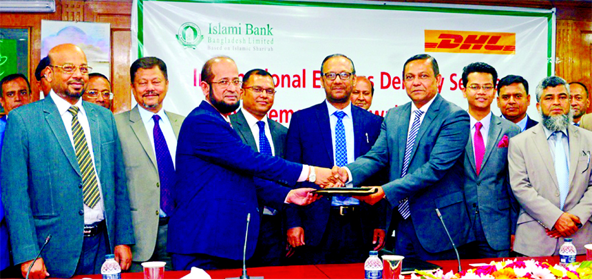Mohammad Ali, DMD of Islami Bank Bangladesh Limited and Md. Miarul Haque, Country Manager of DHL Worldwide Express (BD) Pvt. Limited, exchanging an agreement signing document at the Bank's head office in the city on Monday. Md. Mahbub ul Alam, CEO, Abu Reza Md. Yeahia, JQM Habibullah FCS, Taher Ahmed Chowdhury, Muhammad Qaisar Ali and Hasne Alam, DMDs of the Bank, Sheikh Shahiduzzaman, Manager (Sales) and Al Fattah Md. Azim, Manager (Accounts) of DHL were also present.