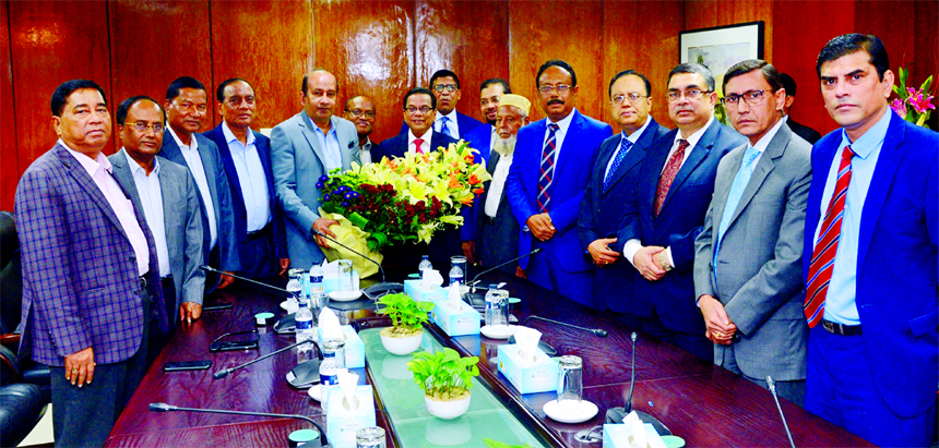 AKM Shaheed Reza, Chairman along with other top officials of Mercantile Bank Limited, bidding farewell with bouquet to Kazi Masihur Rahman, outgoing CEO of the bank upon his retirement from the service at Bank's head office on Tuesday.