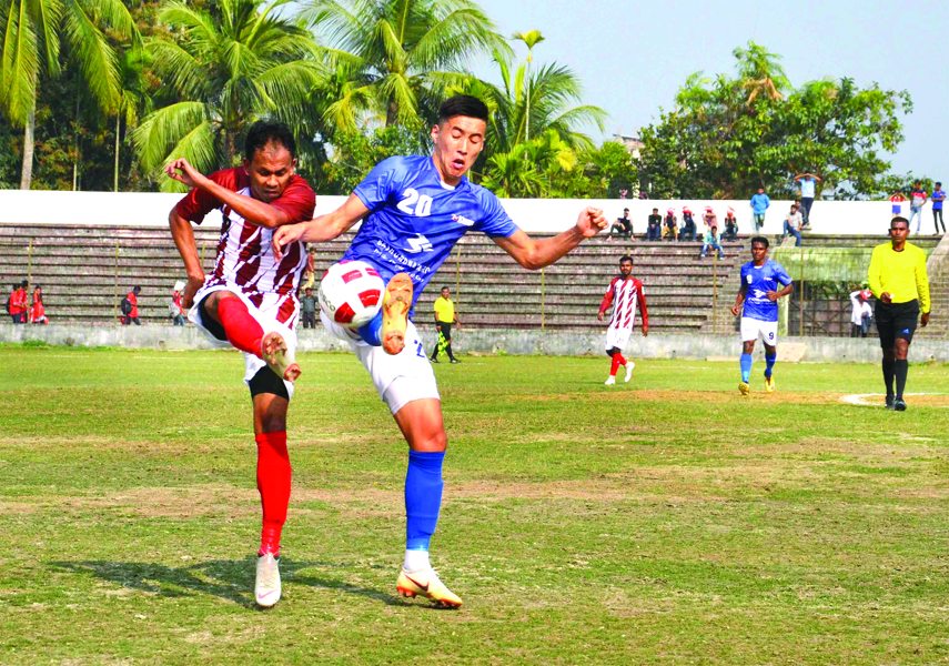 A moment of the football match of the Bangladesh Premier League between Bashundhara Kings and Team BJMC at Shaheed Bhulu Stadium in Noakhali on Tuesday. The match ended in a goalless draw.