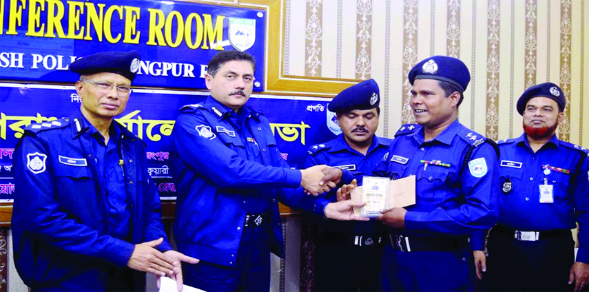 RANGPUR: Devdas Bhatta charya, Deputy inspector General of police  Rangpur Range, distributing awards among police personnel and organisations for their excellence in discharging duties at a function on Tuesday.