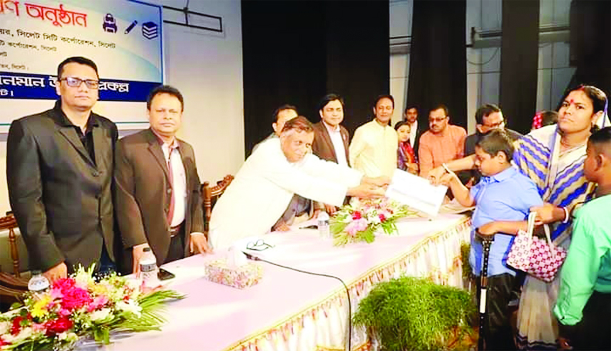 SYLHET:  Ariful Haque Chowdhury, Mayor, Sylhet City Corporation distributing stipend among the needy students  as Chief Guest recently.